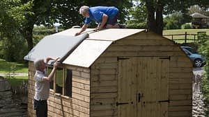 People working on a shed as told in the story