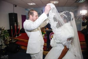 Joe lifting Evelyns veil looking at her with pure Christian love